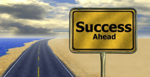 a traffic sign that says ''Success ahead