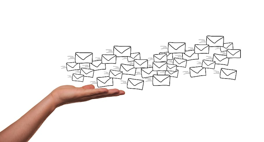 A hand sending a number of cartoonish envelopes simulates online marketing, and contributes to the question is retargeting landing page visitors with Facebook the way to go.