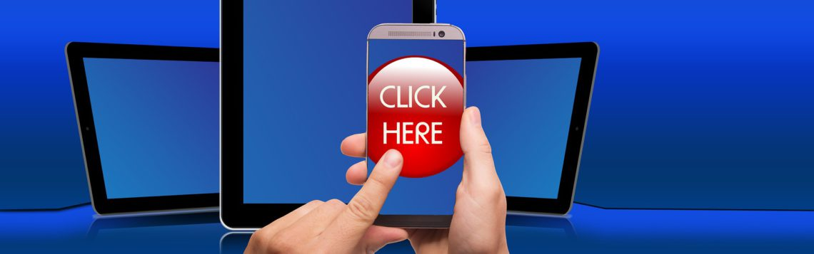 Hand holding a phone with a red button that says ''Click here'' in all caps.