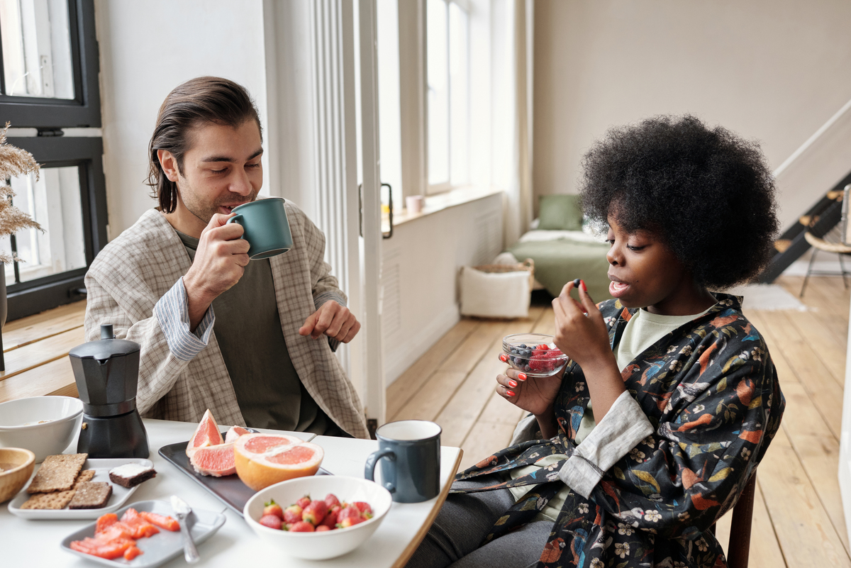 A couple eating breakfast.