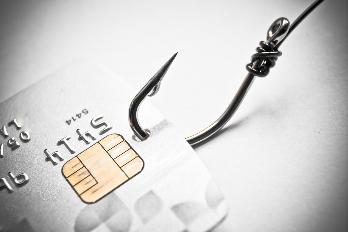 A fishing hook going through a credit card.
