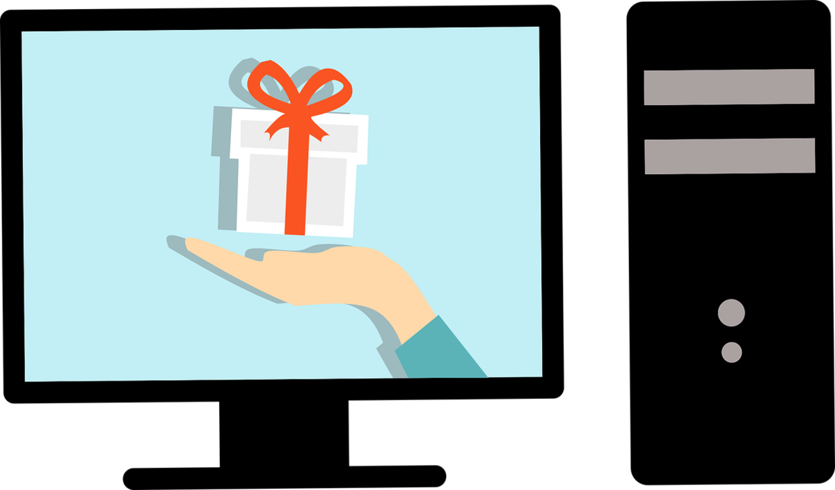 Illustration of a computer with a hand holding a gift on the screen.